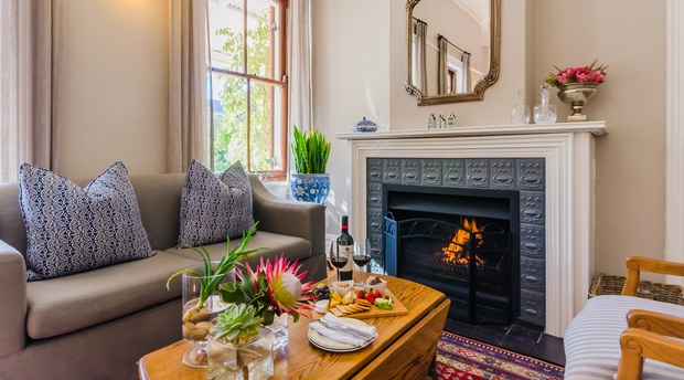 Enjoy a glass of red wine in front of the cosy fire at Bonne Esperance Guest House